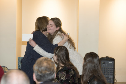 Mary Margaret Justis embraces Emily Jones.