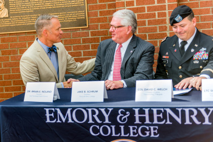 President of ETSU Dr. Brian E. Noland and President Jake B. Schrum shake hands after signing the ...