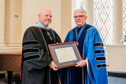 James A. Davis Faculty Award winner Dr. Douglas E. Arnold and President Schrum.