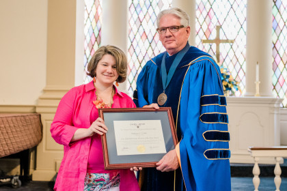 A.L. Mitchell Young Alumnus Award winner Meghann C. Cotter '04 and President Schrum.