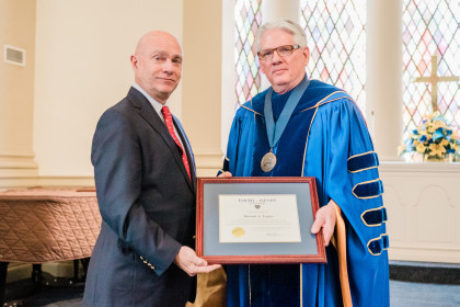 Citation Recipient Award winner Steward A. Taylor '74 and President Schrum