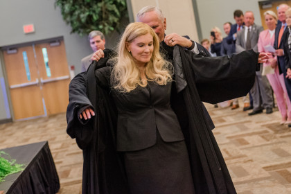 Justice Teresa Chafin being sworn in during her investiture ceremony.