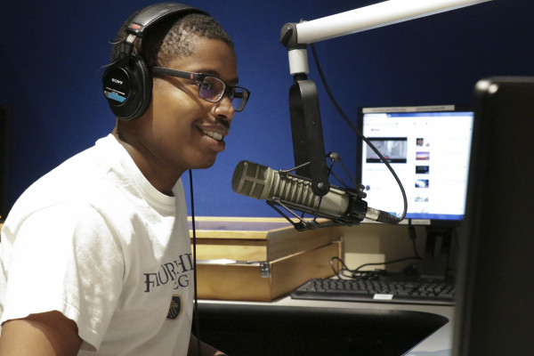 Student Sam Mungai hosts a weekly call-in music request radio show on WEHC 90.7FM.
