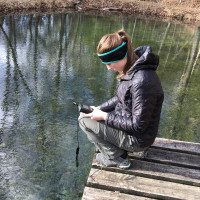 Measuring conductivity in the pond.