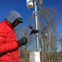 Student deploying a wind speed sensor.
