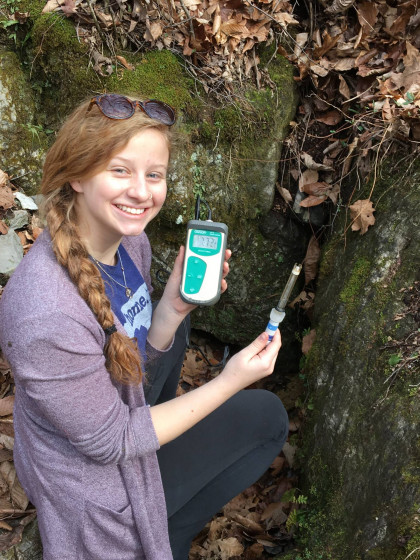 Student measuring stream pH