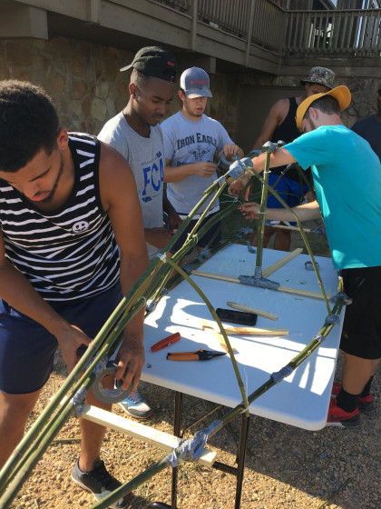 Students building a boat.