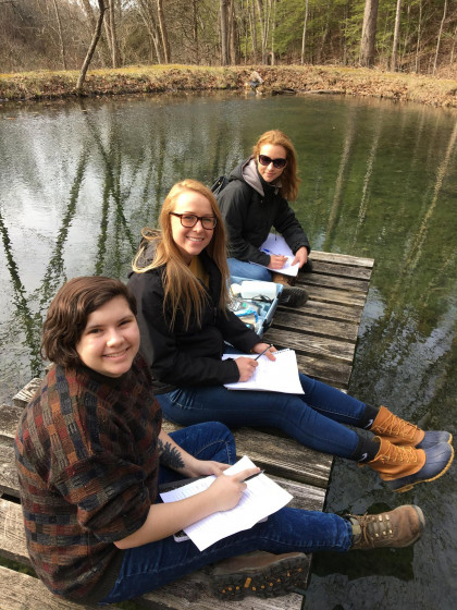 Students measuring water quality on the dock.