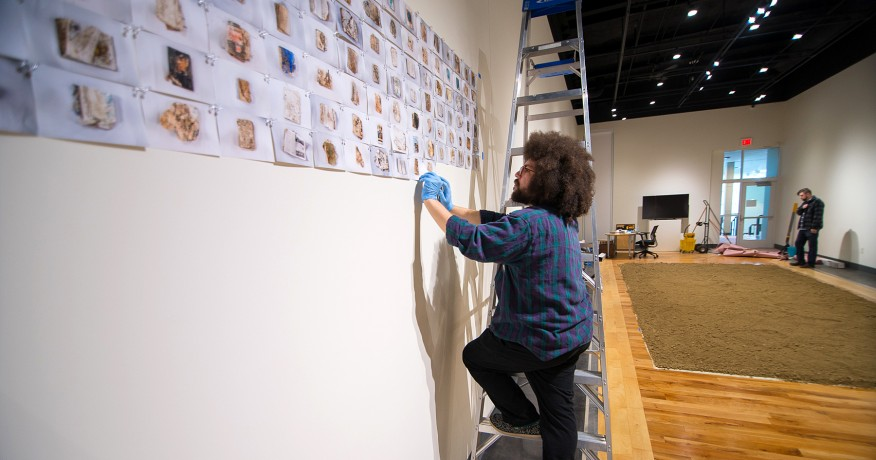 Students work to help install a show at the MCA Art Gallery