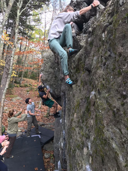 Layne Hubble, a trip leader for the Outdoor Program, boulders in Grayson Highlands.