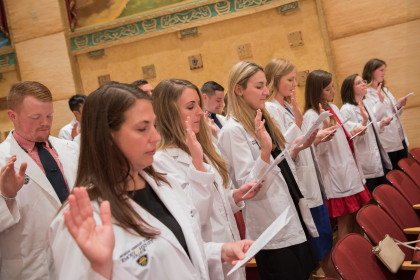 E&H MPAS Class of 2019 Students retaking their PA Student Oath at the 2018 White Coat Ceremony